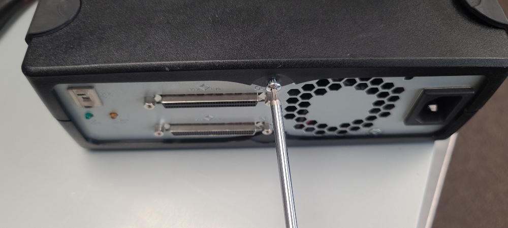 Remove T10 screw from back of case